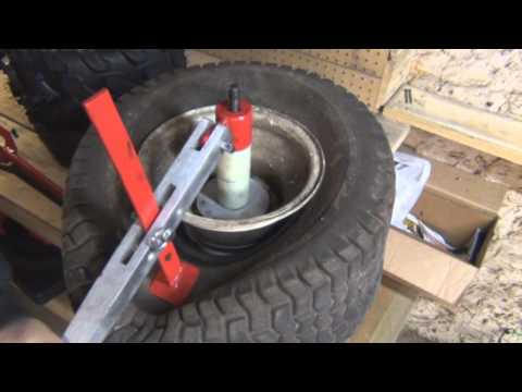putting on a small tractor tire with manual tire machine