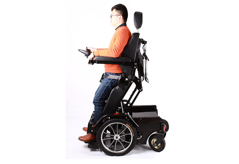 Sit to stand manual wheelchair